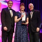 Ella Carlson accepts her award at the Grand Imaging Awards