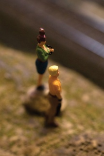 Using the macro capability, I brought the lens in close to capture two miniature figures observing the train environment.