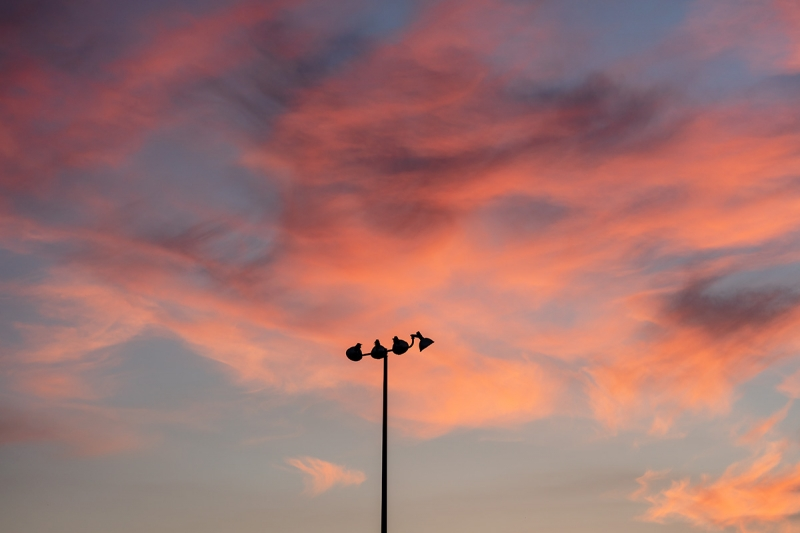 Photographed at f/2, this image shows the sharp light pole silhouetted against a dreamy bokeh sky. This due to a complex asymmetric optical design, which contributes to the heft and size of the lens.