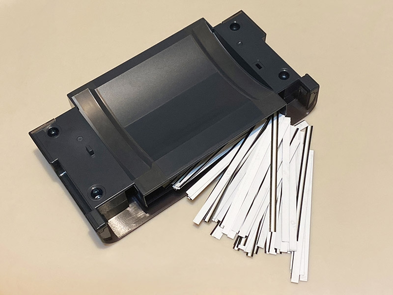 The QW410's paper scrap bin, which stores thin pieces of paper as the printer operates. It looks like you could print close to a thousand prints before the bin would be completely full.