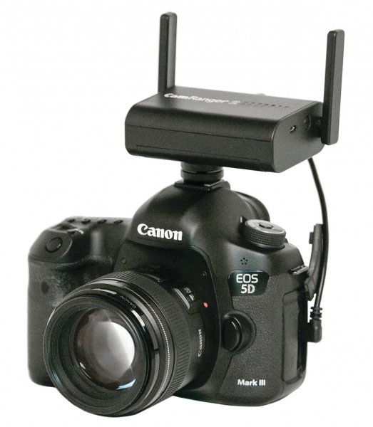 CamRanger 2 mounted on the camera hot shoe with the hot shoe adapter and camera cable, both of which are supplied with the purchase.