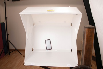 The Foldio3 is a 25x25-inch open-sided light box that folds flat when you need to put it away.